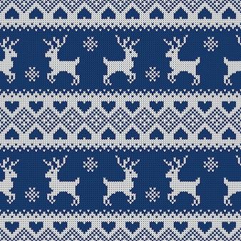 鹿とニットのシームレスなパターン。 。