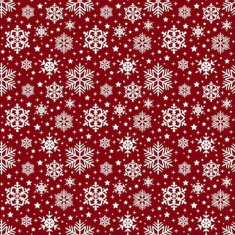 雪片のパターン。シームレスな背景のベクトル。