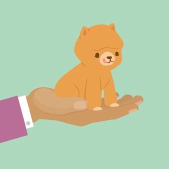 プレゼントのためのペットの子猫、現在のための手にかわいい猫またはペットの概念図を採用。