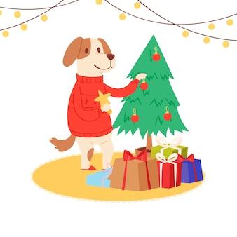赤いサンタセーターを着て漫画犬がクリスマスツリーを飾る