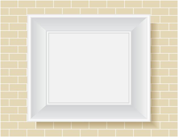 壁に空白のフォトフレーム
