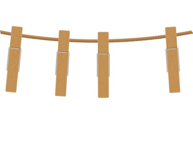 ロープの上の木製の洗濯はさみ
