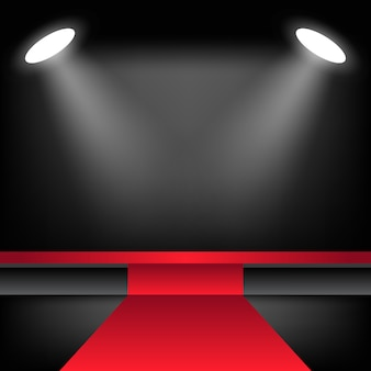 Освещенная сцена с красной ковровой дорожкой