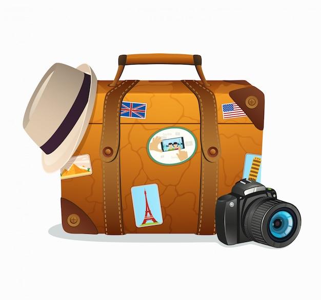 世界中からのティッカーが付いたビンテージ旅行スーツケース