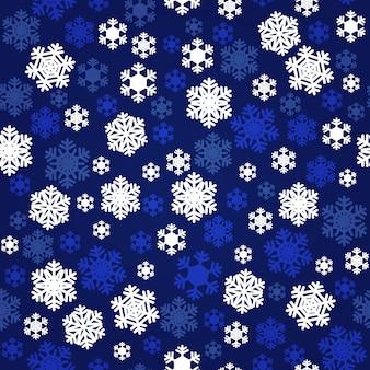 ネイビーブルーと白の雪片のシームレスパターン