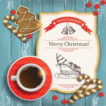 一杯のコーヒーとお祝いのジンジャーブレッドとグリーティングカードクリスマスの背景