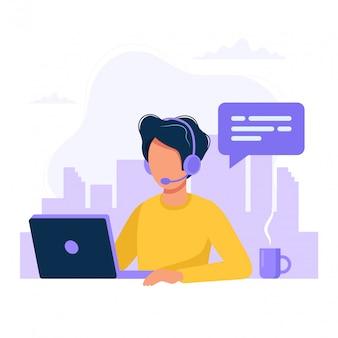 コンピューターとヘッドフォンとマイクを持つ男