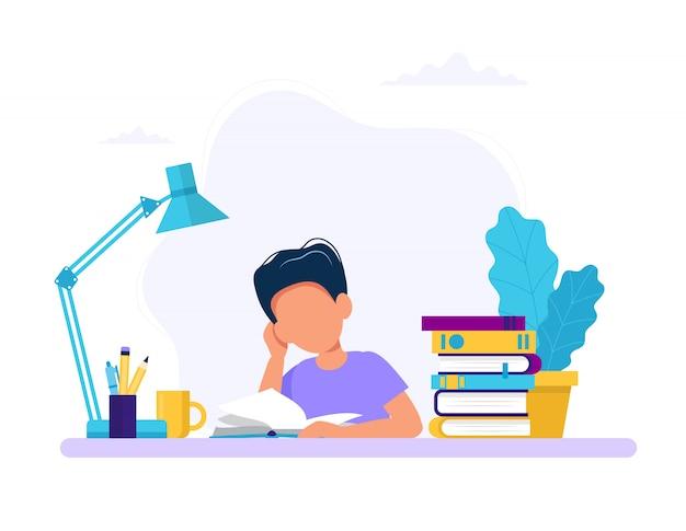 本で勉強している少年。