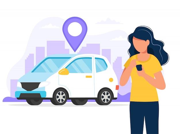 車の場所を見つけるためのアプリでスマートフォンを持つ女性。モバイルアプリ経由のレンタカーサービス。