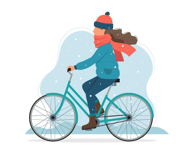 冬に自転車に乗る少女。