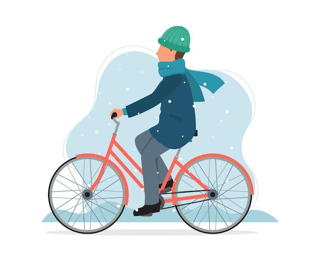 冬に自転車に乗る男。