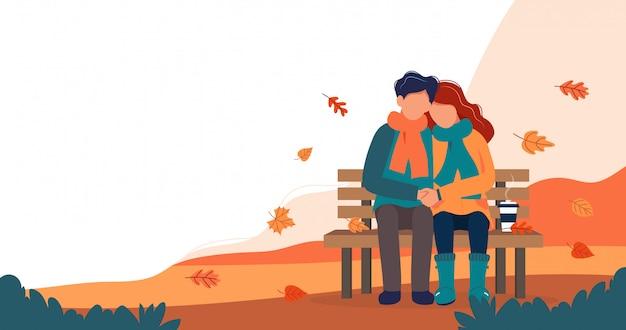 秋のベンチに愛情のあるカップル。