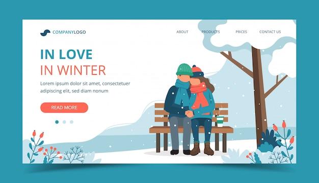Влюбленная пара на скамейке в зимний период.