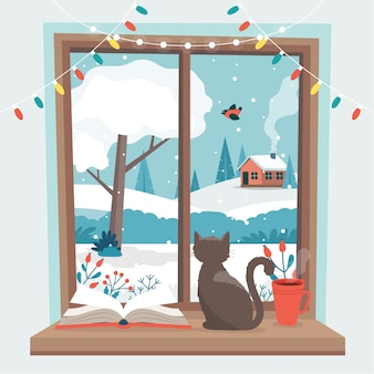 Зимнее окно, с кошкой, книгой и кофейной чашкой на подоконнике.