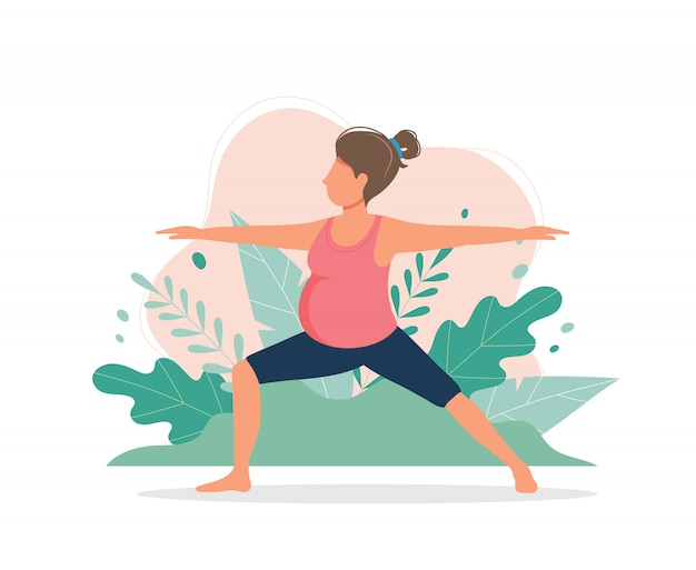 Беременная женщина делает тренировки йоги.
