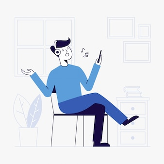 Молодой человек слушая к музыке в живущей комнате.
