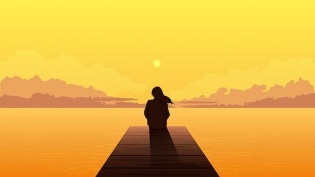 Одинокая девушка силуэт на закате. унылая одна мечтательная женщина сидя смотрящ оранжевый заход солнца.