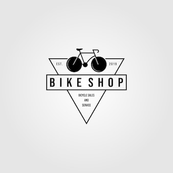 自転車バイクショップのロゴの三角形のミニマリストのビンテージアイコンデザインイラスト