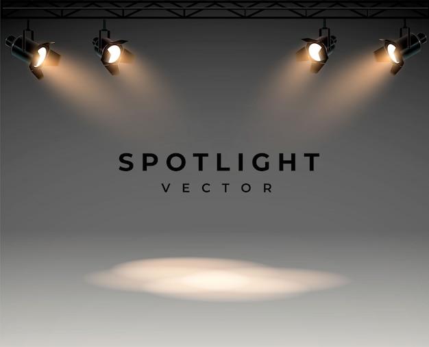 ステージセットを照らす明るい白色光のスポットライトスタジオ照明用プロジェクターのプロジェクターからの照明効果
