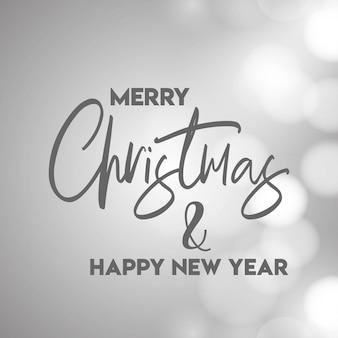 メリークリスマスとハッピーニューイヤー灰色の背景