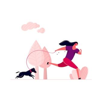 屋外の公園の通りに犬と一緒に走っている女性。朝のひもにつないで犬を連れて歩いて汗の女。ジョギングの女性が家のペットの健康を実行している屋外トレーニング。