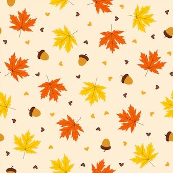 オレンジ色の背景に葉と秋のシームレスパターン