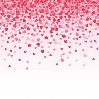 白地にピンクのハートの紙吹雪