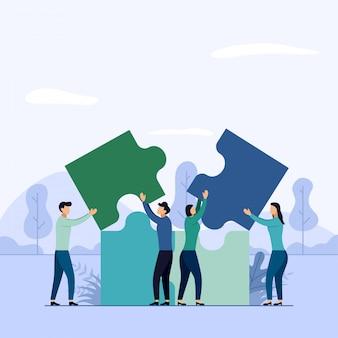 チーム作業、パズルの要素を接続する人々