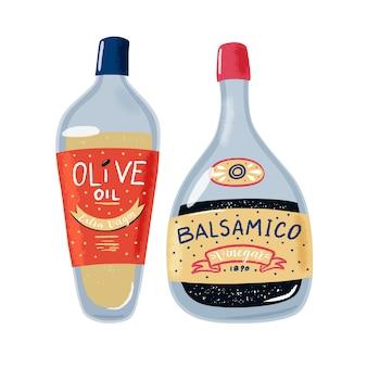 Стеклянные бутылки оливкового масла и бальзамического уксуса