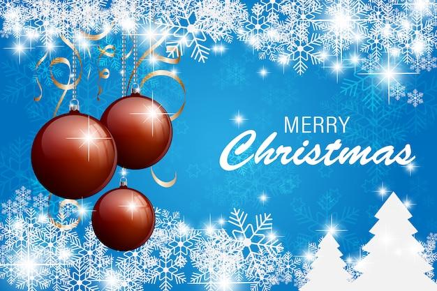 青い雪の結晶の背景を持つ幸せなクリスマスカード