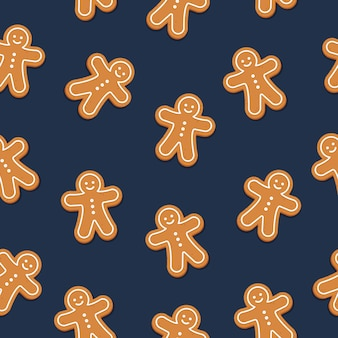 ジンジャーブレッドの男のクッキーシームレスなパターンの青色の背景