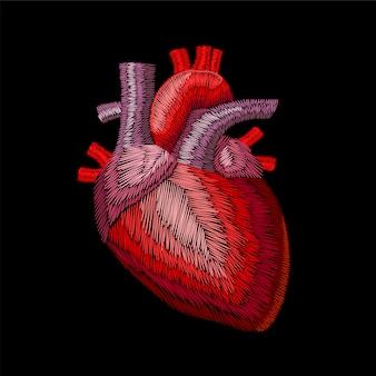 Вышивка экипажем человека анатомического органа медицины сердца.
