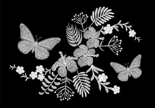 蝶の熱帯刺繍フラワーアレンジメント。エキゾチックなヤシ