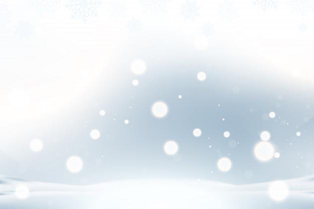 クリスマスと新年の背景に雪片、青色の背景に光の効果。