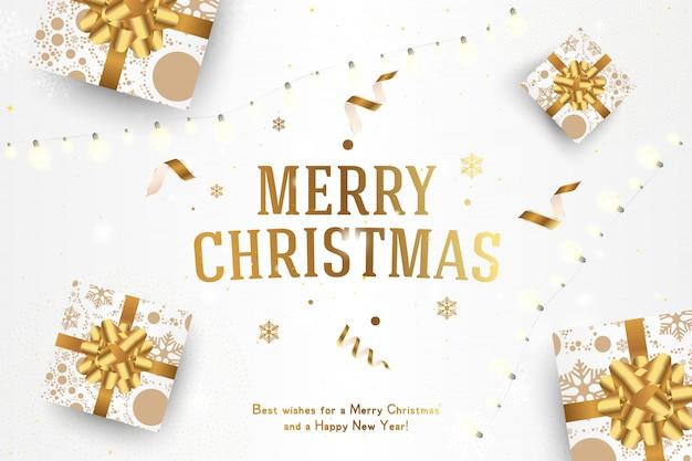 Веселого рождества и счастливого нового года. открытка с надписью и подарками с бантами и гирляндой.