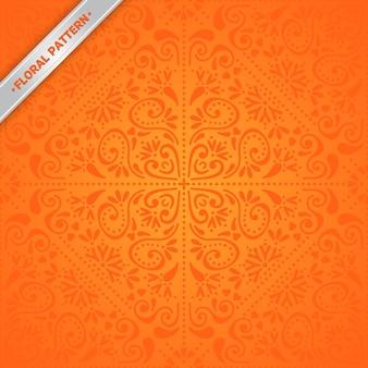 オレンジ色のシームレスな民族柄
