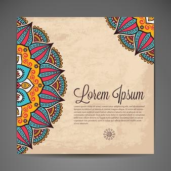 Элегантный индийский орнамент на темном фоне стильный дизайн можно использовать как поздравительную открытку или приглашение на свадьбу