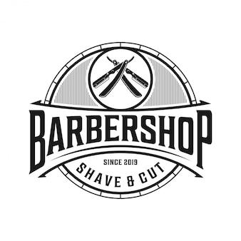 ビンテージスタイルの理髪店のロゴ