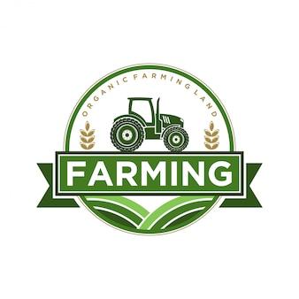 トラクターとシャベルの要素を含む農業産業のためのロゴ