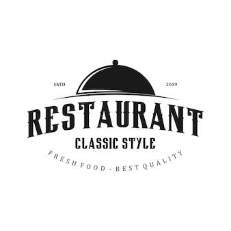 鍋の蓋のアイコンが付いたレストランのロゴ