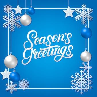 季節は、銀の装飾飾りと手書きのレタリングを挨拶します。