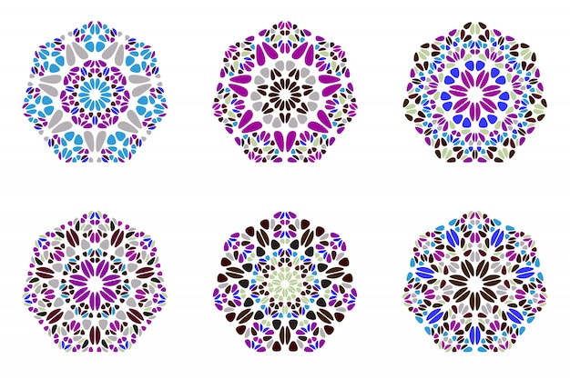幾何学的な抽象的なカラフルな花の七角形セット