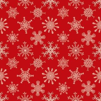 描かれた雪片でシームレスなクリスマス赤パターン