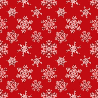 描かれた雪片でシームレスな赤いクリスマスパターン