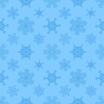描かれた雪片でシームレスなクリスマスブルーパターン