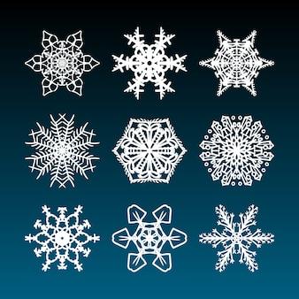 Рождественские снежинки со сложными красивыми и филигранными нарисованными от руки снежными звездами для праздничных украшений