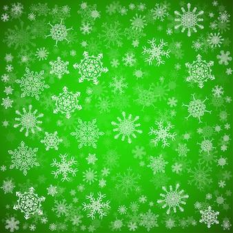 Зеленый новогодний фон с разными снежинками