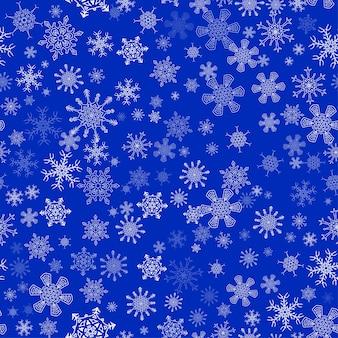 異なる雪と青いシームレスなクリスマスのパターン