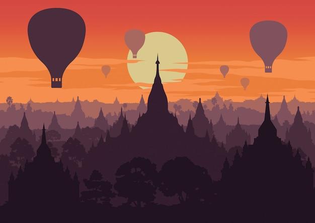 日没時にミャンマーの有名な塔、観光名所の写真を撮る