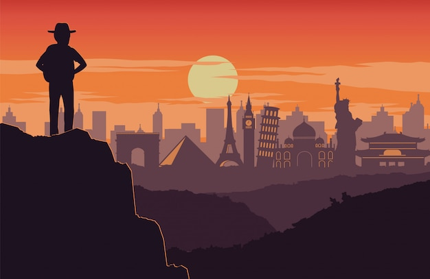 Авантюрист стоит на вершине горы